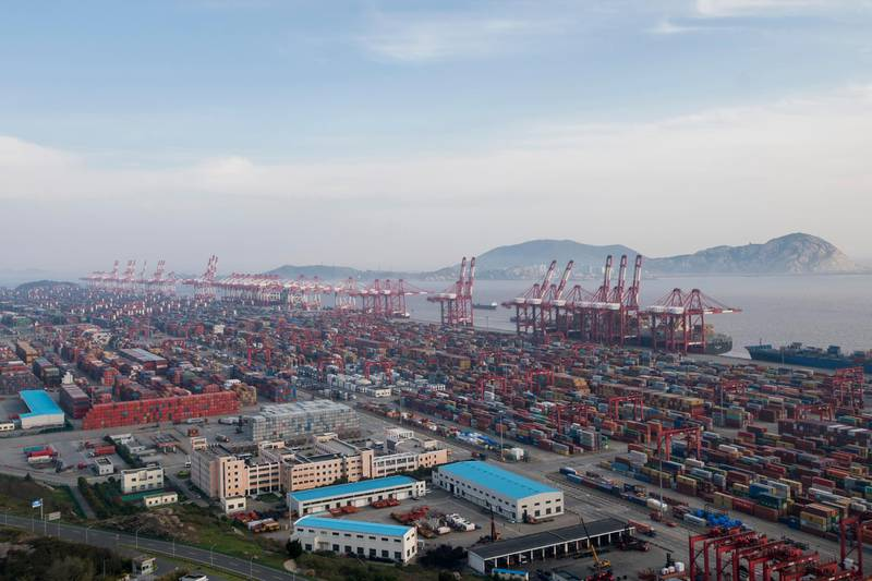 """A container ship is docked at the Yangshan port in Shanghai, Thursday, March 29, 2018. China's Commerce Ministry called on Washington on Thursday to discard planned tariffs it warned might set off a chain reaction that could disrupt global trade and said Beijing will """"fight to the end."""" (AP Photo)"""