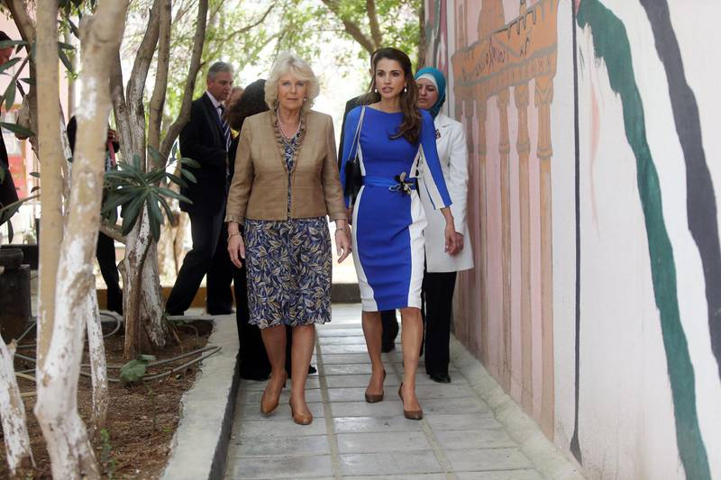 AMMAN, JORDAN - MARCH 12: Camilla, Duchess of Cornwall visits with Queen Rania of Jordan the secondary school of  Mahis on the second day of Charles and Camilla's visit to the country on March  12, 2013,  in Amman, Jordan. The Royal couple are on the first leg of a tour of the Middle East taking in Qatar, Saudia Arabia and Oman. (Photo by Salah Malkawi - Pool /Getty Images)
