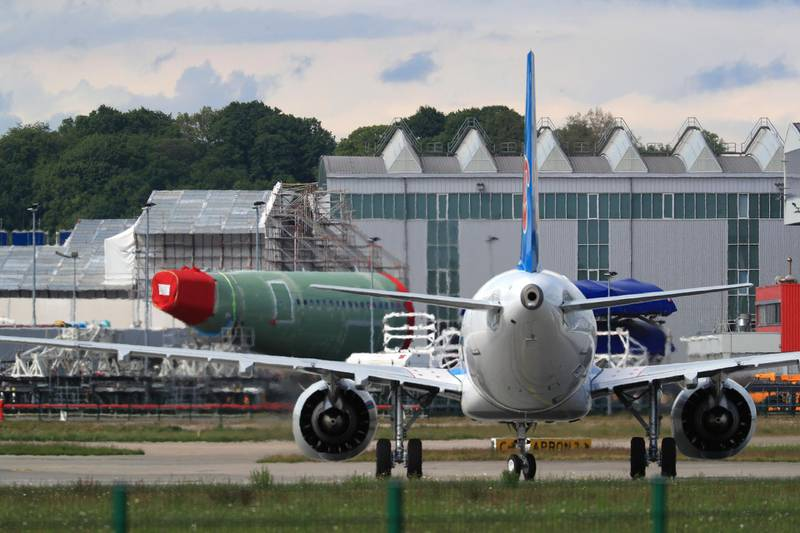 An Airbus A321 NEO passenger aircraft, operated by China Southern Airlines Co., taxis near a fuselage section outside the Airbus SE factory in Hamburg, Germany, on Wednesday, May 13, 2020. Airbus secured just nine net orders in April and delivered 14 jetliners after airlines desperate for cash put off accepting new planes and clamped down on spending to deal with a crisis that could last several years. Photographer: Krisztian Bocsi/Bloomberg
