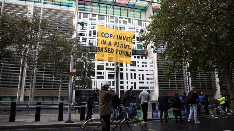 An image that illustrates this article Animal rights activists scale UK government building in Cop26 protest