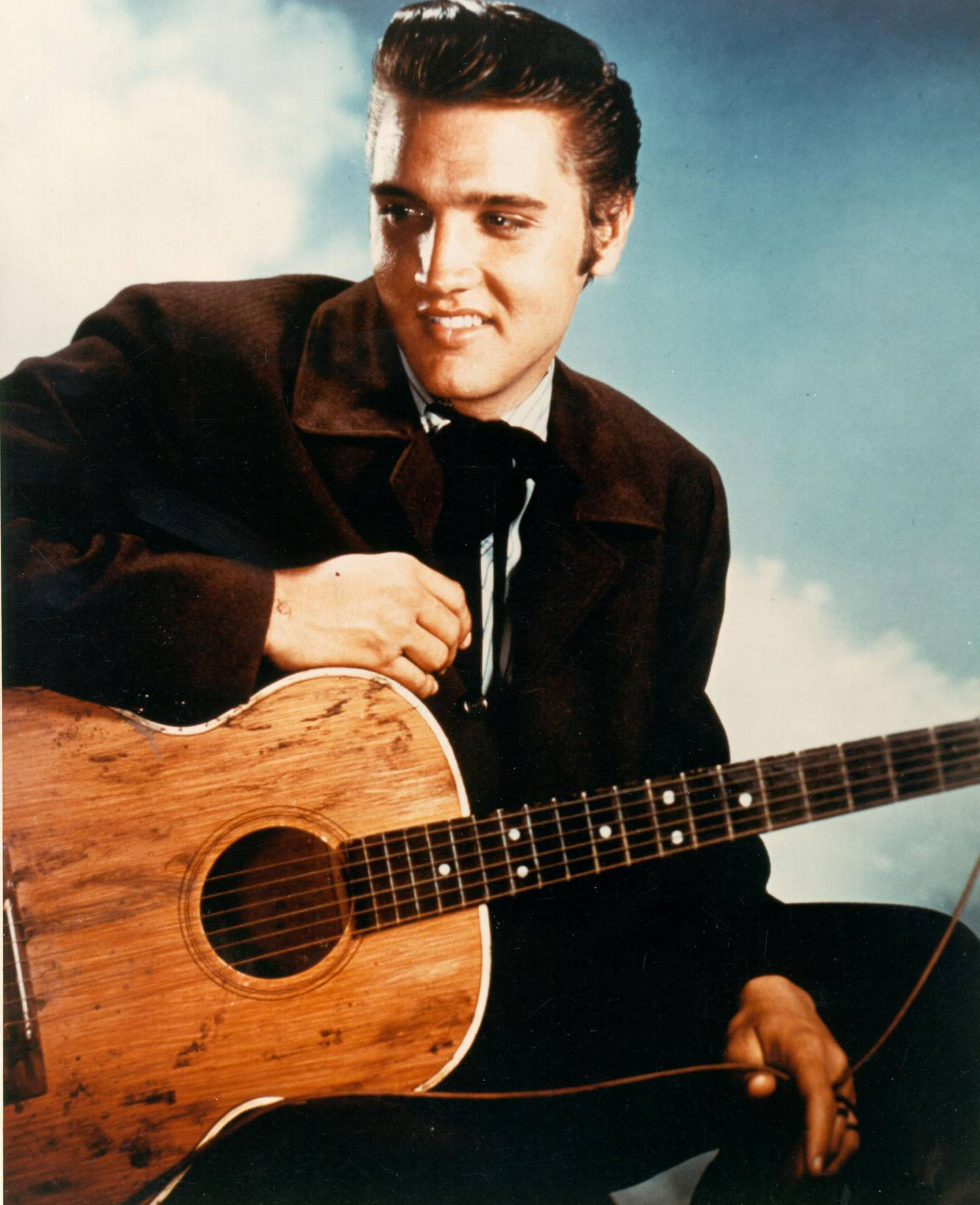 """MALIBU, CA - AUGUST 1956: Rock and roll singer Elvis Presley during the filming of """"Love Me Tender"""" in Los Angeles, CA. (Photo by Michael Ochs Archives/Getty Images)"""