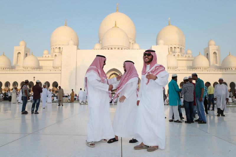 Abu Dhabi, United Arab Emirates, July 17, 2015:    Men from Saudi Arabia greet each other after Eid prayers at Sheikh Zayed Grand Mosque in Abu Dhabi on July 17, 2015. Eid al Fitr marks the end of the holy month of Ramadan. Christopher Pike / The National  Reporter:  N/A Section: News Keywords:    *** Local Caption ***  CP0717-na-EID PRAYERS15.JPG