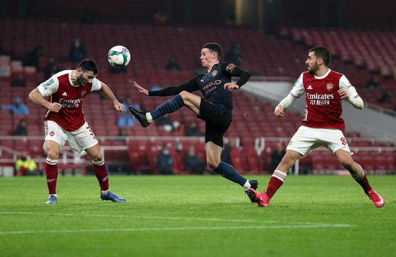 LONDON, ENGLAND - DECEMBER 22: Sead Kolasinac of Arsenal defends from Phil Foden of Manchester City  during the Carabao Cup Quarter Final match between Arsenal and Manchester City at Emirates Stadium on December 22, 2020 in London, England. The match will be played without fans, behind closed doors as a Covid-19 precaution. (Photo by Catherine Ivill/Getty Images)