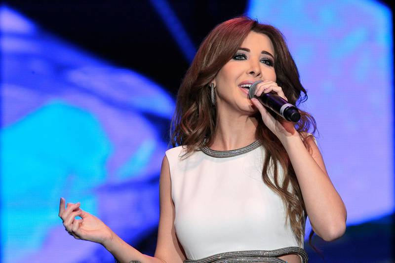 Dubai, United Arab Emirates - January 10, 2015.  Nancy Ajram in concert, during the DSF 20th anniversary.  ( Jeffrey E Biteng / The National )  Editor's Note; Saeed S reports. *** Local Caption ***  JB100115-Nancy11.jpg