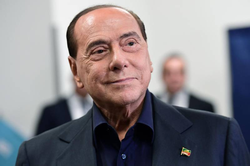 (FILES) In this file photo taken on May 26, 2019 former Italian PM and leader of the right-wing party Forza Italia Silvio Berlusconi leaves the polling station after casting his vote in Milan. Former Italian premier Silvio Berlusconi has been admitted to hospital in Monaco after suffering heart problems, a spokesman and his doctor said on January 14, 2021. / AFP / Miguel MEDINA