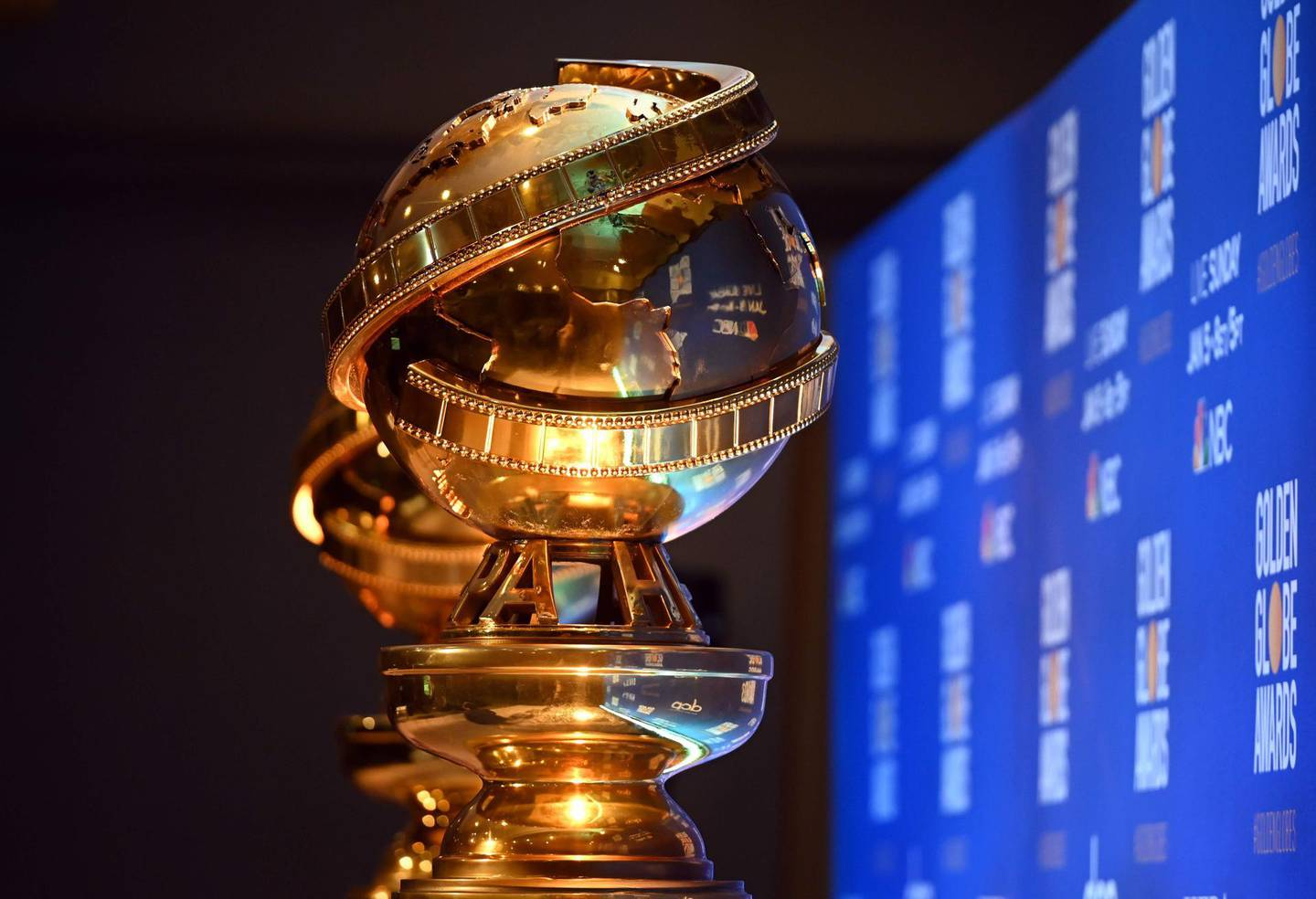"""(FILES) In this file photo taken on December 9, 2019, Golden Globe statues are set by the stage ahead of the 77th Annual Golden Globe Awards nominations announcement in Beverly Hills. Next year's Golden Globes will take place on February 28,  said the Hollywood Foreign Press Association in a statement on June 22, 2020, an unusually late date for the glitzy film and television award show as Hollywood scrambles to adjust to the coronavirus pandemic.  The Globes, which are typically held in early January, will take the weekend previously reserved for the Oscars, which last week were delayed by eight weeks to April 25.  / AFP / Robyn BECK / TO GO WITH AFP STORY by Andrew MARSZAL and Javier TOVAR, """"Golden Globes rev up award season with Netflix in pole position"""""""