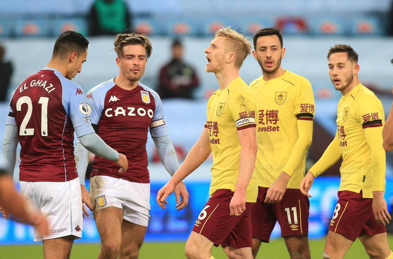 Burnley's Ben Mee, centre, reacts during the English Premier League soccer match between Aston Villa and Burnley at Villa Park stadium in Birmingham, England, Thursday, Dec. 17, 2020. (Lindsey Parnaby/Pool via AP)