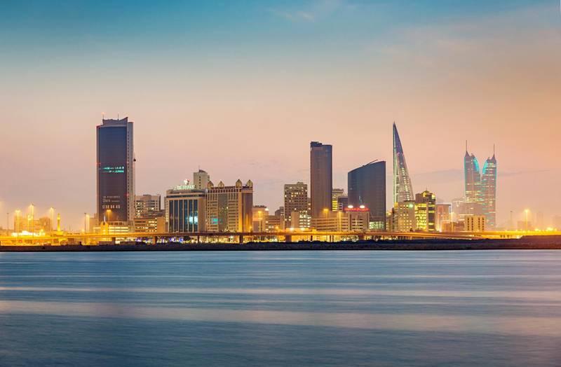Bahrain Manama Skyline at Twilight, Manama Cityscape with office buildings, hotels and the world trade center of the capital of Bahrain illuminated  at night under beautiful skyscape. Manama, Bahrain, Middle East.