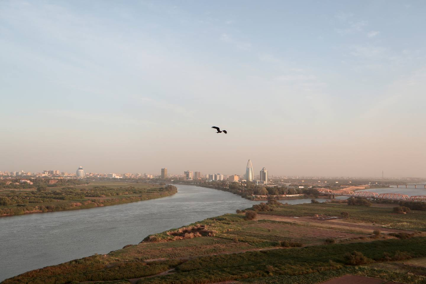 FILE PHOTO: A bird flies over the convergence between the White Nile river and Blue Nile river in Khartoum, Sudan, February 17, 2020. REUTERS/Zohra Bensemra/File Photo