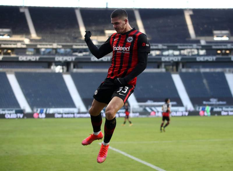 FRANKFURT AM MAIN, GERMANY - FEBRUARY 14: Andre Silva of Eintracht Frankfurt  celebrates after scoring their team's first goal  during the Bundesliga match between Eintracht Frankfurt and 1. FC Koeln at Deutsche Bank Park on February 14, 2021 in Frankfurt am Main, Germany. Sporting stadiums around Germany remain under strict restrictions due to the Coronavirus Pandemic as Government social distancing laws prohibit fans inside venues resulting in games being played behind closed doors. (Photo by Alex Grimm/Getty Images)