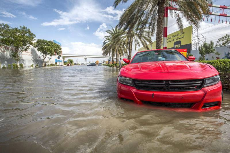 Dubai, United Arab Emirates - Abandoned cars at the road crossing the Batuta area and Discovery Gardens due to heavy rains yesterday.  Ruel Pableo for The National
