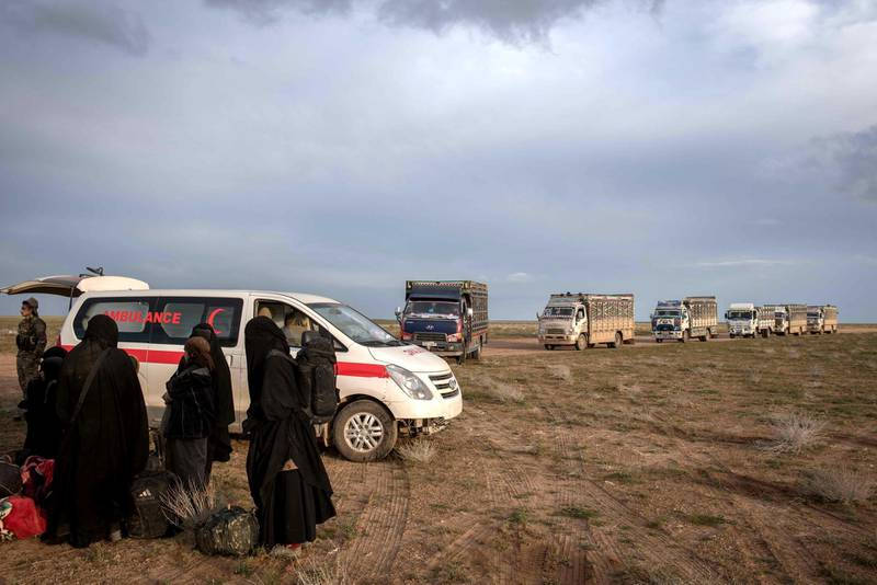 Trucks evacuating people from the last pocket of ISIS territory in Syria arrive outside Baghouz, 28 February 2019. Campbell MacDiarmid