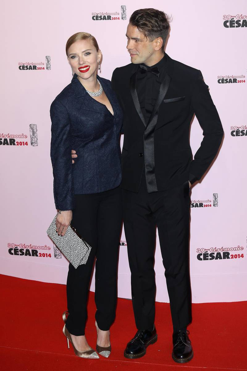 PARIS, FRANCE - FEBRUARY 28:  (L-R) Scarlett Johansson and  Romain Dauriac arrive for the 39th Cesar Film Awards 2014 at Theatre du Chatelet on February 28, 2014 in Paris, France.  (Photo by Marc Piasecki/Getty Images)