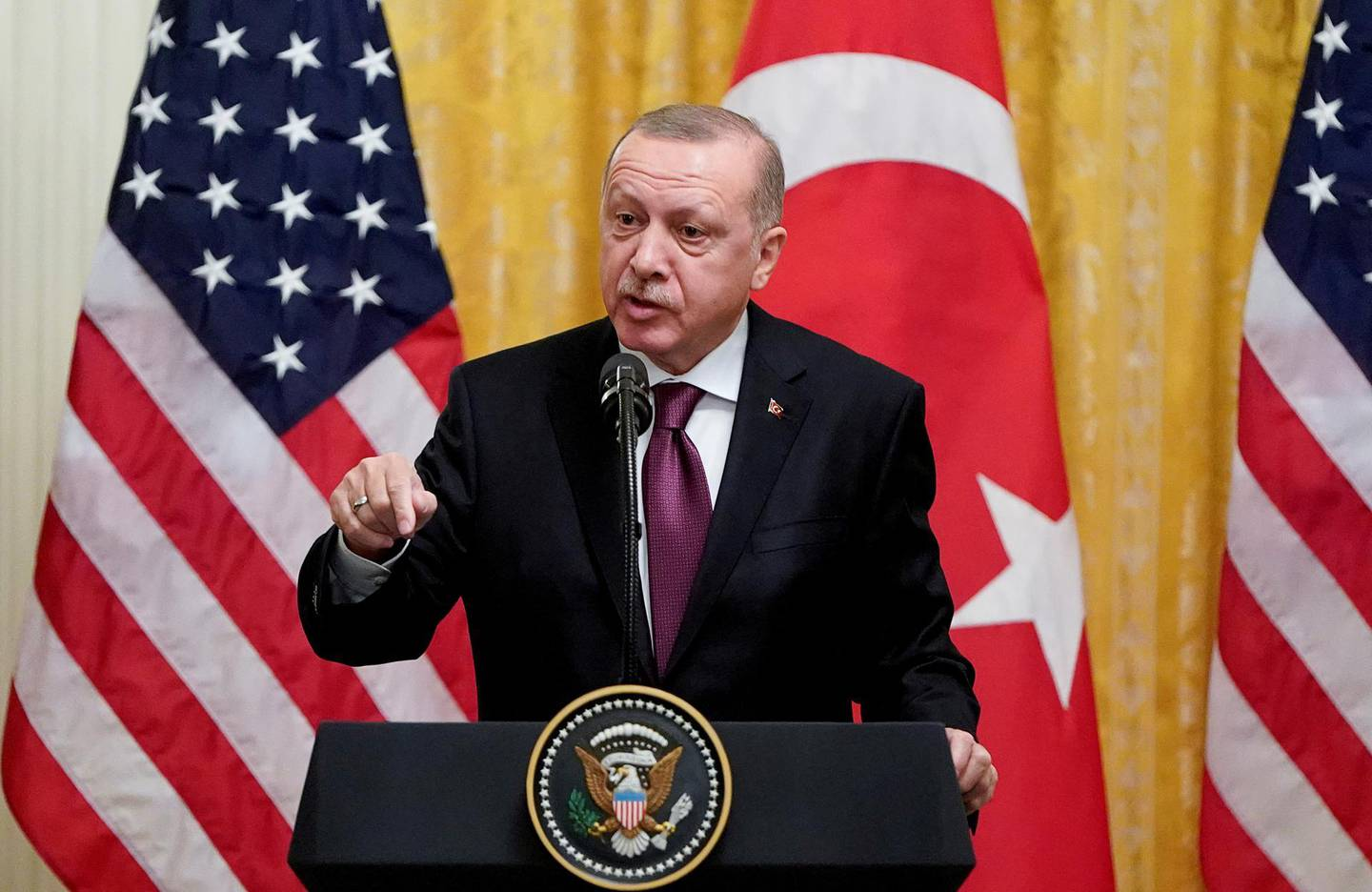 FILE PHOTO: Turkish President Tayyip Erdogan answers questions during a joint news conference with U.S. President Donald Trump at the White House in Washington, U.S., November 13, 2019. REUTERS/Joshua Roberts/File Photo