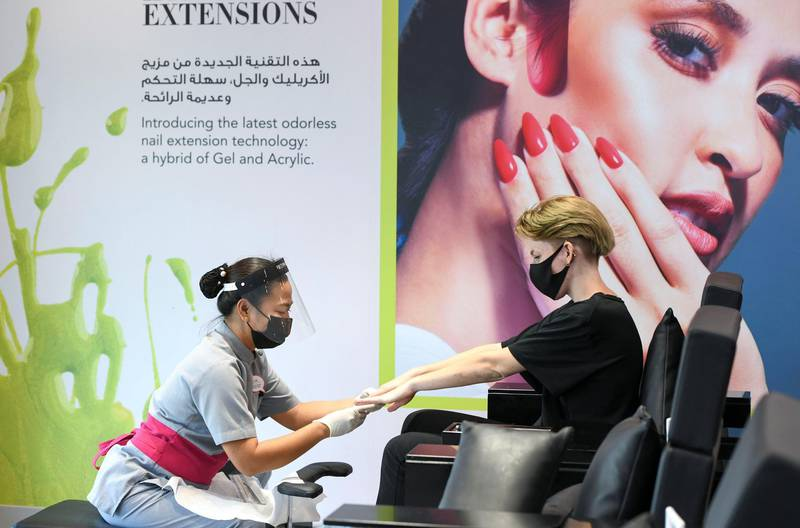Abu Dhabi, United Arab Emirates - Nail technician prepares for a manicure at Bedashing Beauty Lounge salon in Shakhbout City. Khushnum Bhandari for The National