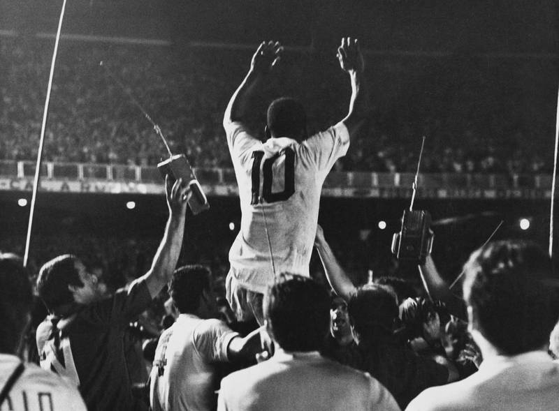 Pele is lifted up by his Santos team mates after scoring the 1,000th goal of his career during a game against Vasco da Gama at the Maracana Stadium, Rio de Janeiro, Brazil, 19th November 1969. (Photo by Pictorial Parade/Archive Photos/Getty Images)