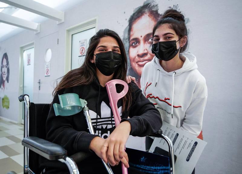 Abu Dhabi, United Arab Emirates, January 12, 2021. SEHA Vaccination Centre at the Abu Dhabi Cruise Terminal area.  Sisters Aya-24 and Jana-18 get vaccinated.Victor Besa/The NationalSection:  NAReporter:  Shireena Al Nowais