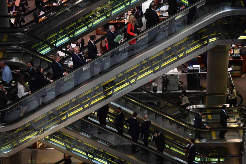 (FILES) In this file photo taken on March 30, 2017 The interior of Lloyd's of London, the centuries-old insurance market, is pictured in the City of London on March 30, 2017. The image of the British financial sector is of a world of overpaid men, a symbol of glaring wage inequalities and women's difficulties in gaining access to the highest positions. New regulations have forced the big names in British finance to publish wage differentials between men and women and the numbers are not flattering. / AFP PHOTO / BEN STANSALL