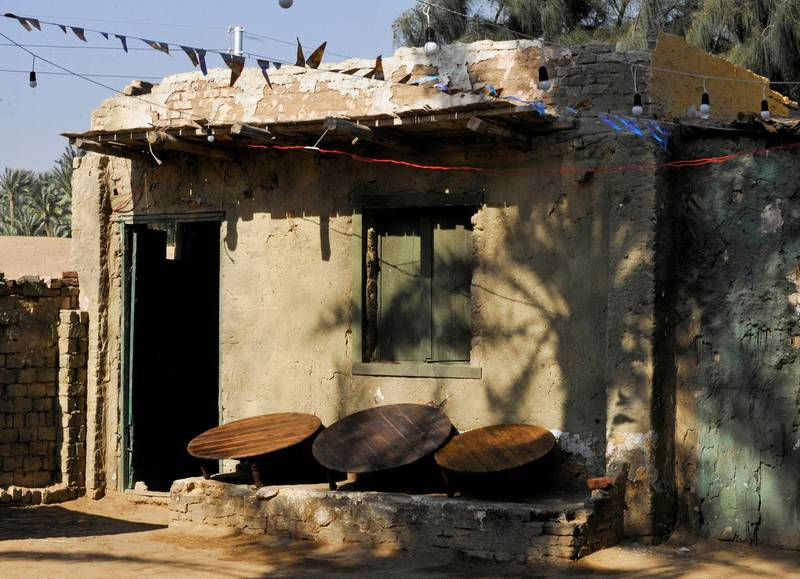 Tables are seen outside the house of a couple who try to improve their living conditions by selling food to tourists, in Saqqara village in Giza, Egypt, April 27, 2021. Picture taken April 27, 2021. REUTERS/Shokry Hussien