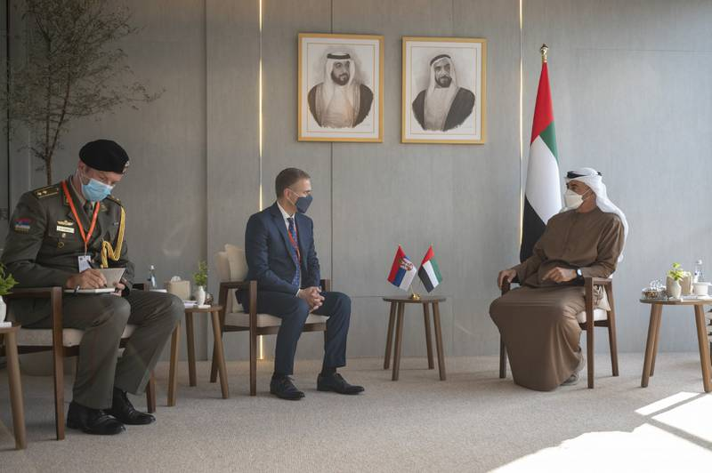 ABU DHABI, UNITED ARAB EMIRATES - February 23, 2021: HH Sheikh Mohamed bin Zayed Al Nahyan, Crown Prince of Abu Dhabi and Deputy Supreme Commander of the UAE Armed Forces (R) meets with HE Nebojsa Stefanovic, Deputy Prime Minister and Minister of Defence of Serbia (C), during the International Defence Exhibition and Conference 2021 (IDEX), at ADNEC.  ( Rashed Al Mansoori / Ministry of Presidential Affairs ) ---