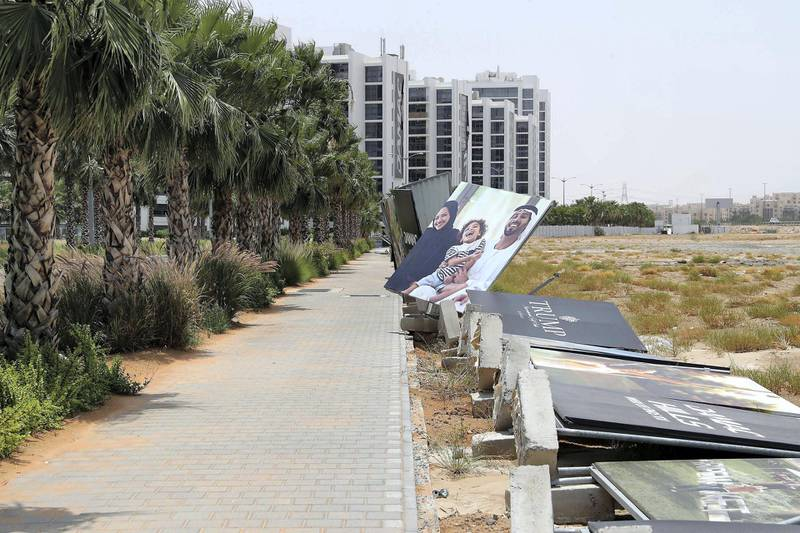 DUBAI, UNITED ARAB EMIRATES , May 25– 2020 :- Barriers around Damac Hills damaged because of last night storm in Dubai.  (Pawan Singh / The National) For News/Online. Story by Nick Webster