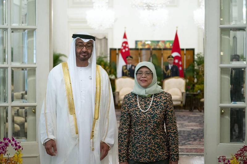 SINGAPORE, SINGAPORE - February 28, 2019: HH Sheikh Mohamed bin Zayed Al Nahyan, Crown Prince of Abu Dhabi and Deputy Supreme Commander of the UAE Armed Forces (L), stands for a photograph with HE Halimah Yacob, President of Singapore, (R), during a reception at the Istana presidential palace. ( Ryan Carter / Ministry of Presidential Affairs )