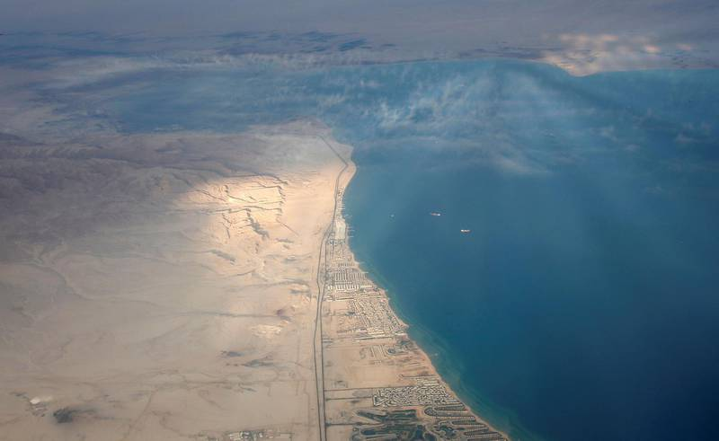 An aerial view of the coast of the Red Sea is pictured through the window of an airplane near Sharm el-Sheikh, Egypt December 16, 2017. Picture taken December 16, 2017. REUTERS/Amr Abdallah Dalsh