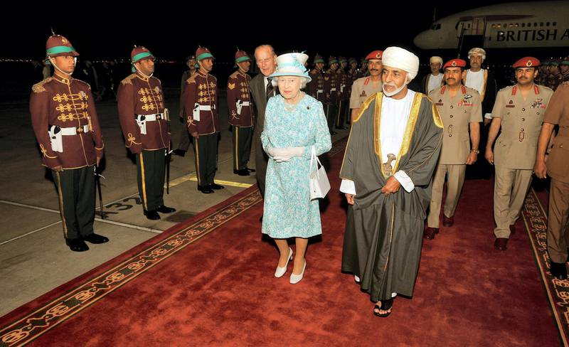 MUSCAT, OMAN - NOVEMBER 25: Queen Elizabeth II walks with the Sultan of Oman, His Majesty Qaboos bin Said Al Said, after arriving from the UAE on November 25, 2010 in Muscat, Oman.  Queen Elizabeth II and Prince Philip, Duke of Edinburgh are in Oman on a State Visit to the Middle East. The Royal couple spent two days in Abu Dhabi and will stay three days in Oman. (Photo by John Stillwell-Pool/Getty Images)