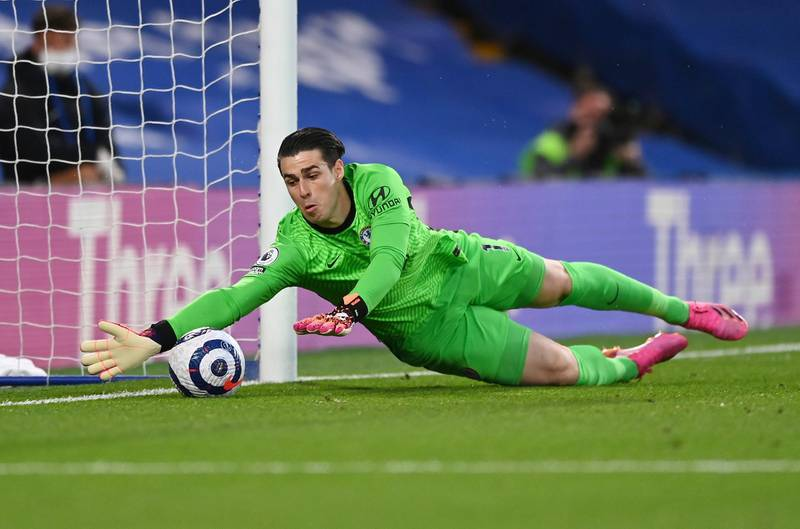 Chelsea's goalkeeper Kepa Arrizabalaga takes a safe during the English Premier League soccer match between Chelsea and Arsenal at Stamford Bridge stadium in London, England, Wednesday, May 12, 2021. (Shaun Botterill, Pool via AP)