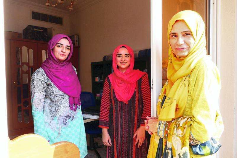Najma with her daughters Neha Mohammed Tahir (center) and Jawahir Mohammed Tahir (left) at her home in Dubai on June 5 , 2021. During the isolation of her daughters, she used to check on them from the home balcony.  Pawan Singh / The National.
