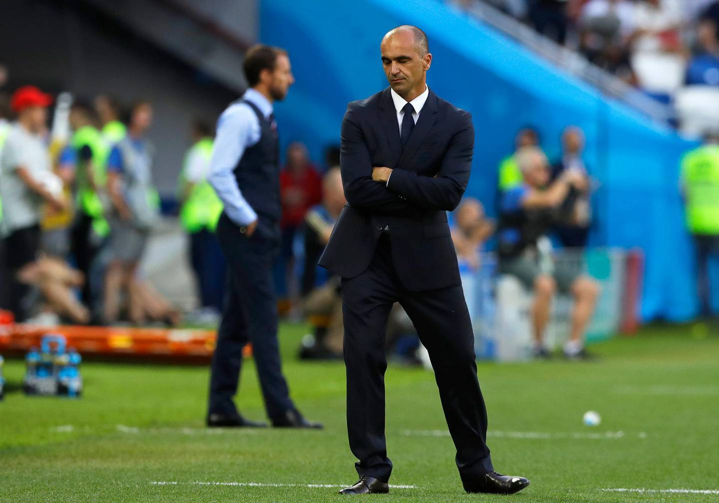Belgium coach Roberto Martinez and England head coach Gareth Southgate, in the background, stand on the sideline during the group G match between England and Belgium at the 2018 soccer World Cup in the Kaliningrad Stadium in Kaliningrad, Russia, Thursday, June 28, 2018. (AP Photo/Alastair Grant)