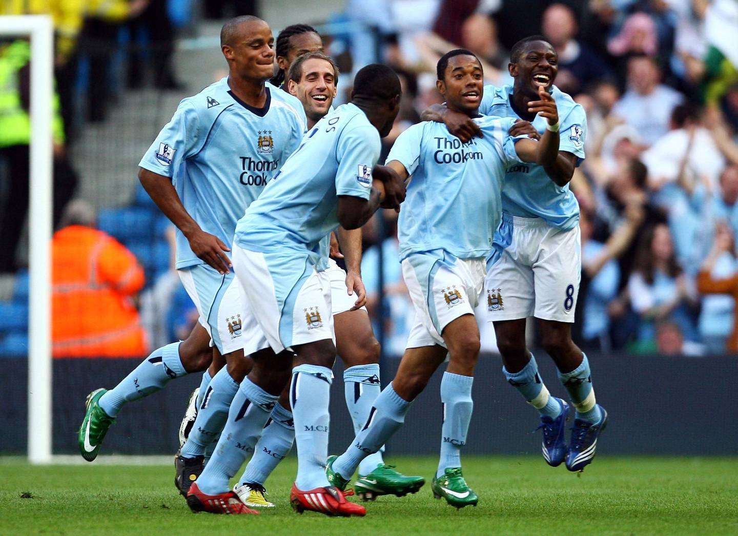 MANCHESTER, UNITED KINGDOM - SEPTEMBER 13:  Robinho of Manchester is mobbed by team mates after scoring the first goal of the game during the Barclays Premier League match between Manchester City and Chelsea at The City of Manchester Stadium on September 13, 2008 in Manchester, England.  (Photo by Alex Livesey/Getty Images)