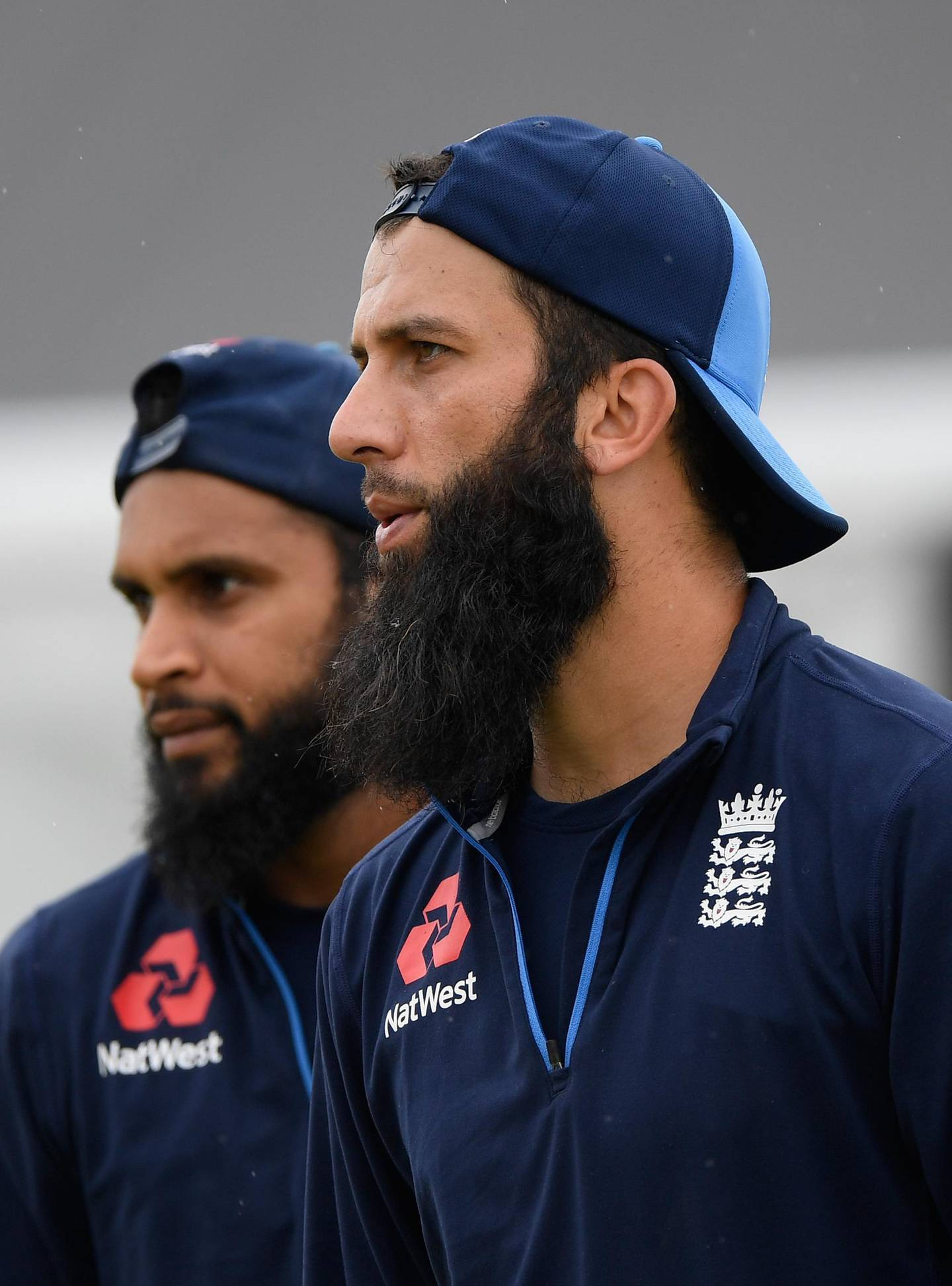 TAURANGA, NEW ZEALAND - FEBRUARY 27:  England spinners Adil Rashid (l) and Moeen Ali look on during nets ahead of the 2nd ODI at the Bay Oval on February 27, 2018 in Tauranga, New Zealand.  (Photo by Stu Forster/Getty Images)