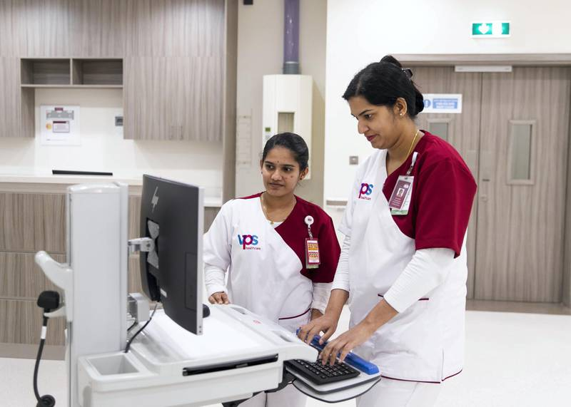 ABU DHABI, UNITED ARAB EMIRATES. 23 MARCH 2020.Nurses, from left to right, Anjali Sunitha Nair and Elsa Rani James.Nursing team from VPS healthcare have been working around the clock for two weeks to test thousands of airline passengers arriving into the UAE for Covid-19.(Photo: Reem Mohammed/The National)Reporter:Section: