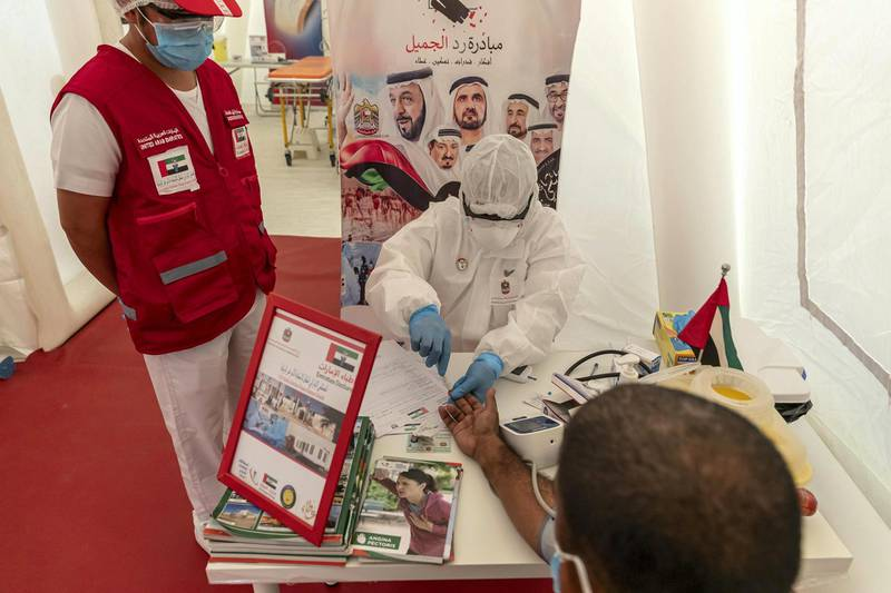 AJMAN, UNITED ARAB EMIRATES. 20 APRIL 2020. COVID-19 Filed Hospital set up next to the Ajman Saudi German Hospital. Dr Adel Abdulla Abdullazi Alshamry Alajami, Intensive Care Unit.  The UAE Mobile Infectious Disease Response Hospital. testee's are served in the triage area of the hospital. (Photo: Antonie Robertson/The National) Journalist: Salam Al Amir. Section: National.