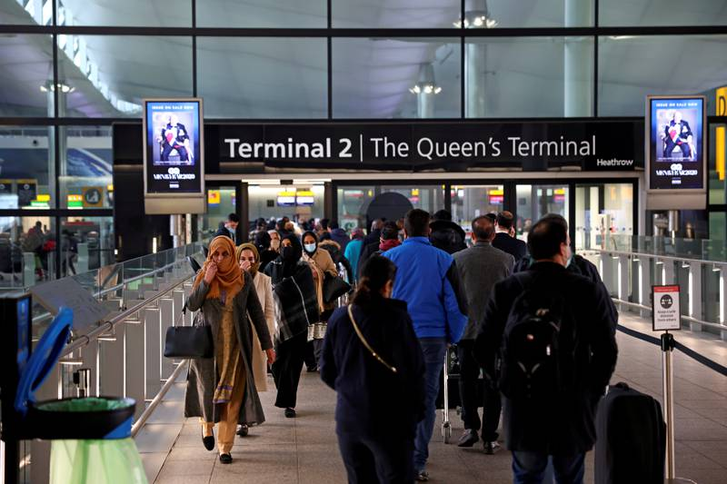 FILE PHOTO: People queue to enter terminal 2, as tighter rules for international travellers start, at Heathrow Airport, amid the spread of the coronavirus disease (COVID-19) pandemic, London, Britain, January 18, 2021. REUTERS/Henry Nicholls/File Photo