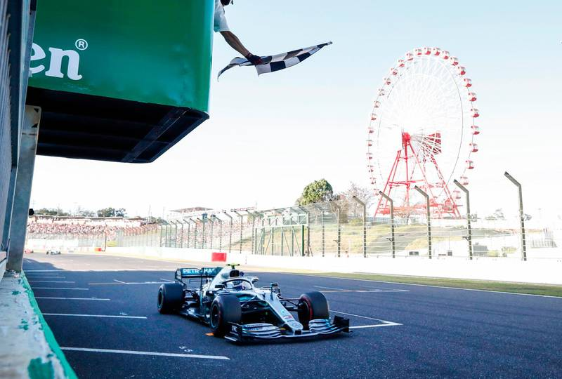 Mercedes' Finnish driver Valtteri Bottas takes the checkered flag to win during the Formula One Japanese Grand Prix in Suzuka on October 13, 2019. / AFP / POOL / Kim Hong-Ji