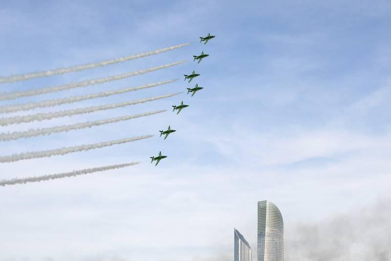 Abu Dhabi, United Arab Emirates - Al Fursan aerobatic demonstration lights up the skyline of Abu Dhabi on December 2, 2018. (Khushnum Bhandari/ The National)