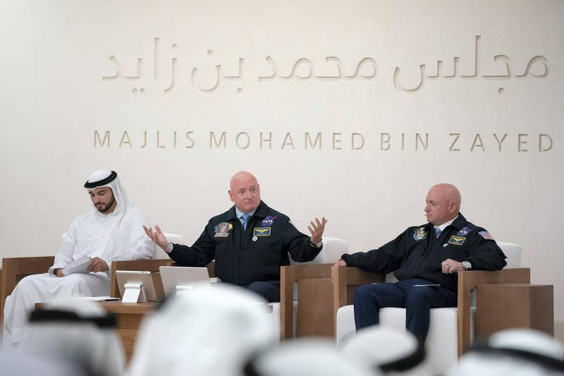 ABU DHABI, UNITED ARAB EMIRATES - June 04, 2018: Captain Mark Kelly (R) and Scott Kelly (C), present a lecture titled, 'The Sky is not the Limit: Life Lessons from NASA's Kelly Brothers', at Majlis Mohamed bin Zayed.  ( Hamad Al Kaabi / Crown Prince Court - Abu Dhabi ) ---