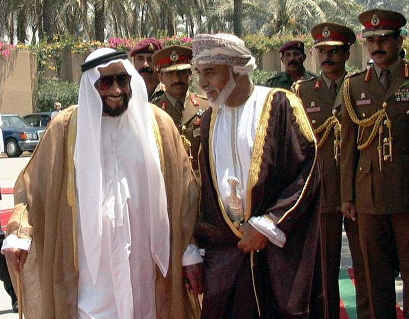 Omani Sultan Qaboos (R) walks with Emirati President Sheikh Zayed ibn Sultan al-Nahayan in Sohar 01 May 1999. The two leaders signed an accord laying out the demarcation of part of their common border, which in the past has led to conflicts over property ownership between nationals of the two countries. (Photo by WAM / AFP)