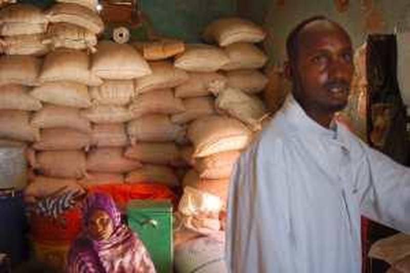 6. Food 6: Bags of sorghum intended to be given out as food aid are stacked in a warehouse at a market in Burao, Somalia. Corrupt officials steal food aid and sell it in markets, locals say. MATT BROWN/THE NATIONAL