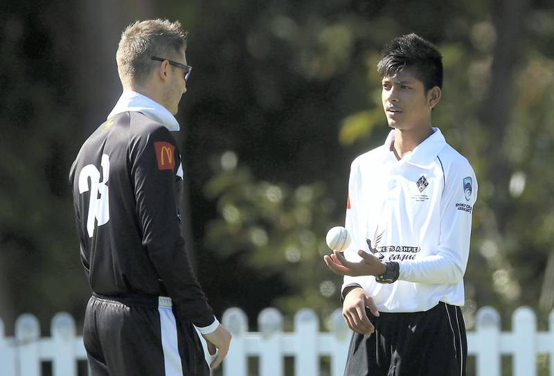 SYDNEY, AUSTRALIA - SEPTEMBER 24:  Michael Clarke of Western Suburbs talks to team mate Sandeep Lamichhane before the Mosman v Western Suburbs first grade match at Allan Border Oval on September 24, 2016 in Sydney, Australia.  (Photo by Mark Metcalfe/Getty Images)