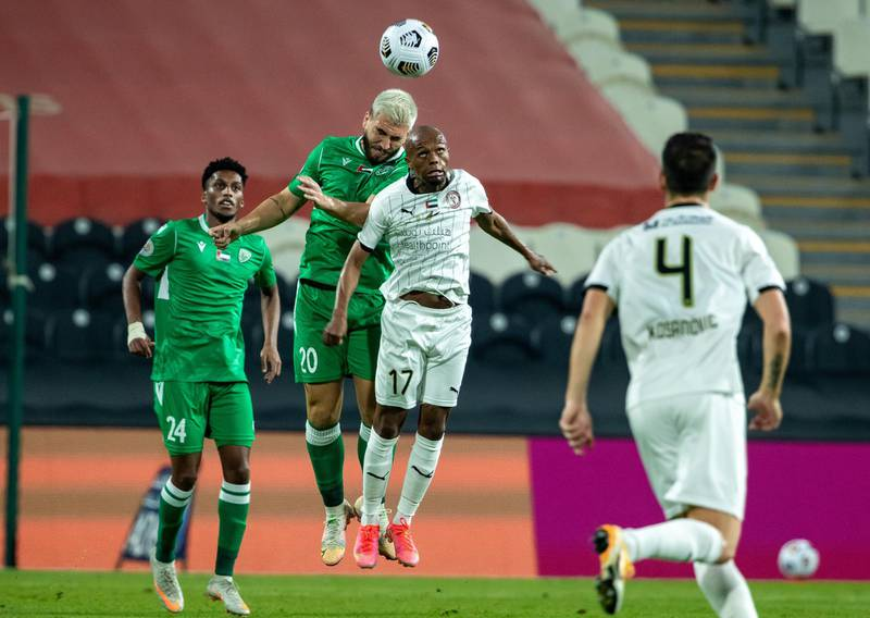 Arabian Gulf League final round: Al Jazira v Khorfakkan at Mohamed bin Zayed stadium. Serero of Jazira battles for a header with Bruno Lamas of Khorfakkan during the first half of the game on May 11th, 2021. Victor Besa / The National.