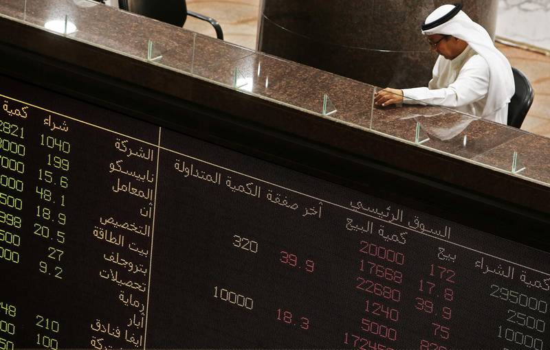 A trader follows the stock market at Boursa Kuwait, the national stock market of Kuwait, on September 19, 2019 in Kuwait City. Saudi shares slumped at the start of trading on September 15, the first session after drone attacks on two major oil facilities knocked out more than half the OPEC kingpin's production. Other bourses in the Gulf also dropped. Dubai Financial Market was down 1.1 percent, Abu Dhabi and Qatar markets declined 0.4 percent each, while Kuwait shares sank 0.8 percent and Bahrain's bourse slid 0.9 percent. / AFP / Yasser Al-Zayyat