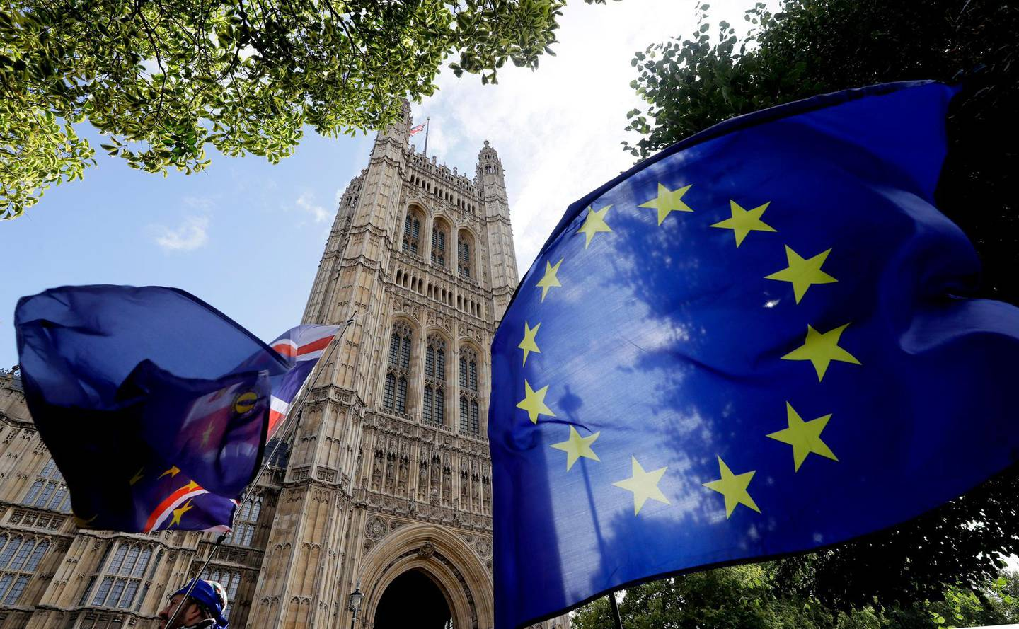 """A European Union flag flies near Britain's Parliament in London, Thursday, Sept. 26, 2019. An unrepentant Prime Minister Boris Johnson brushed off cries of """"Resign!"""" and dared his foes to try to topple him Wednesday at a raucous session of Parliament, a day after Britain's highest court ruled he acted illegally in suspending the body ahead of the Brexit deadline. (AP Photo/Kirsty Wigglesworth)"""