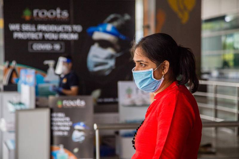 DELHI, INDIA - MAY 26: An Indian taveller wearing a protective mask waits at the drop-off point of Terminal 3 of the Indira Gandhi International Airport, as the country relaxed its lockdown restriction on May 26, 2020 in Delhi, India. With a slew of guidelines for passengers, India allowed commercial domestic flights to resume operations on May 25 for the first time since imposing a nationwide lockdown on March 25 to curb the spread of coronavirus, which has reportedly claimed around 4,000 lives in India so far.  (Photo by Yawar Nazir/Getty Images)