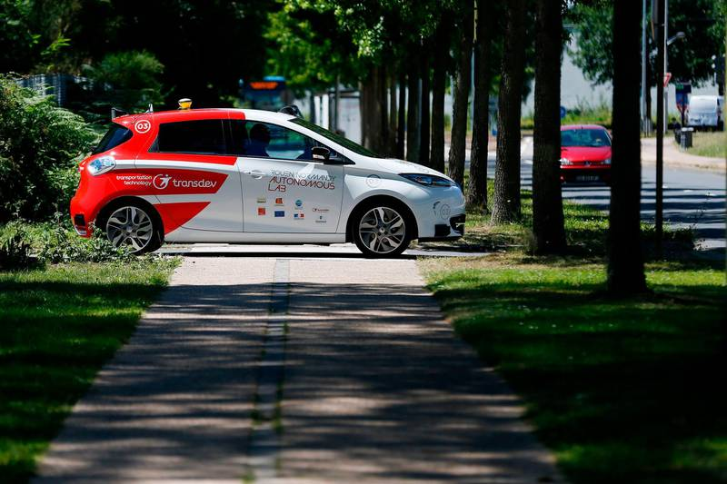 (FILES) In this file photograph taken on June 26, 2018, an autonomous car drives past during a press presentation in the north-western French city of Sotteville-lès-Rouen, near Rouen.   In the not-too-distant future, driverless cars may have to choose between saving their passengers or pedestrians when faced with unavoidable accidents. But how should they decide?. It's one of the thorniest issues faced by policymakers and manufacturers as we edge closer to a future where autonomous vehicles fill our roads, and a new study offers some potential principles based on a survey of millions of people. / AFP / CHARLY TRIBALLEAU