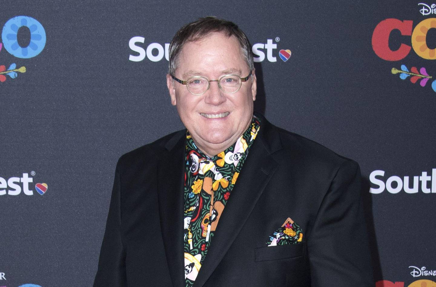 """(FILES) In this file photo taken on November 8, 2017, Executive producer John Lasseter attends the Disney Pixar's """"COCO"""" premiere in Hollywood, California. British actress Emma Thompson has quit an anticipated film produced by California's Skydance studios because it hired former Disney creative director John Lasseter, who is accused of sexual harassment, her publicist told AFP on February 26, 2019. -   / AFP / VALERIE MACON"""