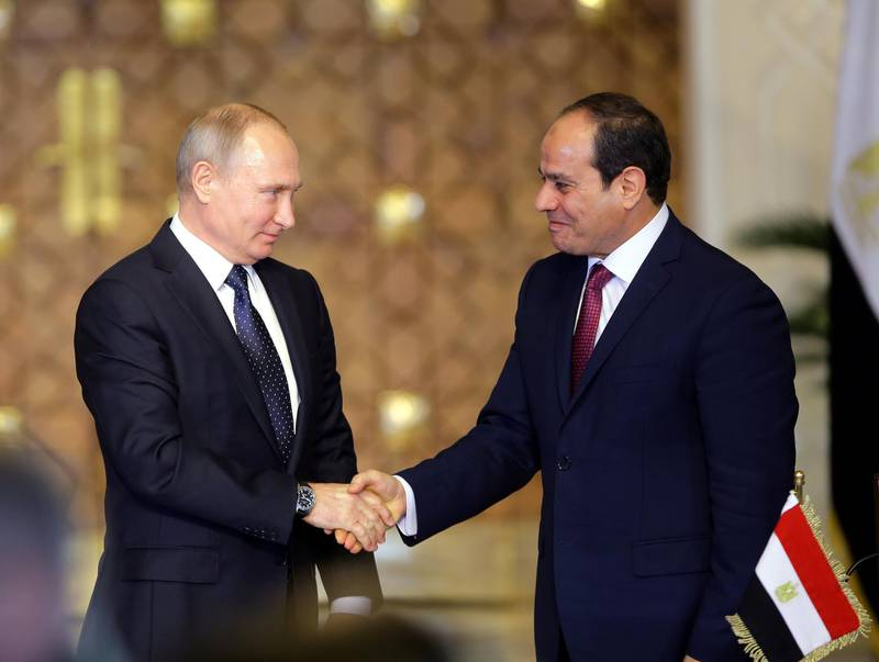 epa06383075 Egyptian President Abdel Fattah al-Sisi (R) and Russian President Vladimir Putin shake hands after a news conference following their talks in Cairo, Egypt, 11 December 2017. Putin arrived in Cairo to discuss with his Egyptian counterpart regional and bilateral issues, including the construction of a nuclear power plant and the resumption of Russian flights to Egypt.  EPA/KHALED ELFIQI
