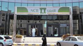 NCB's full year profit surges 19% as costs fall